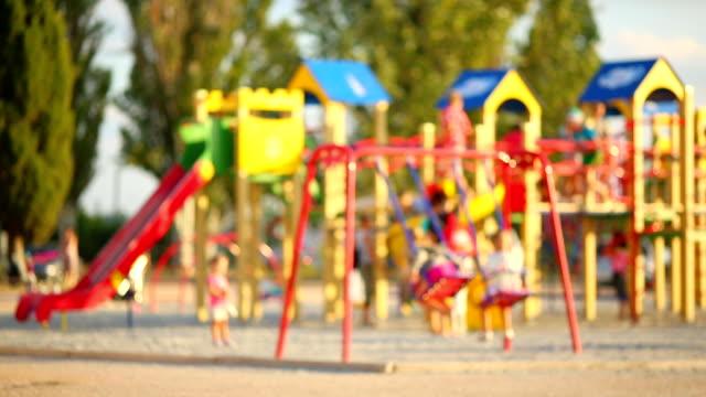 children playing in the playground - defocus