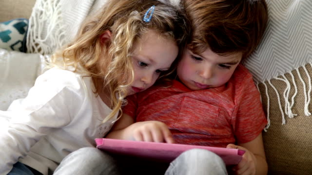 Children Playing on a Digital Tablet