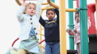MS LA PAN Children playing on monkey bars on playground / Richmond, Virginia, USA