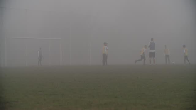 4K: Children playing soccer