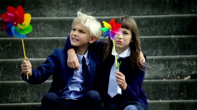 Children playing with pinwheel in stairs background