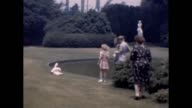 1957 Children Playing With Swan in Park