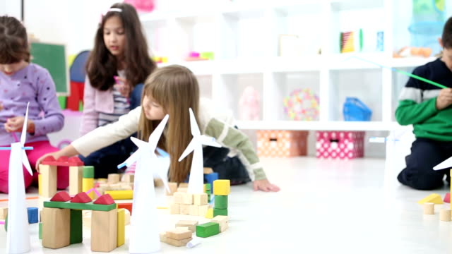 HD: Children Playing With Wind Turbine and blocks.