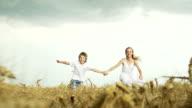 Children running in wheat