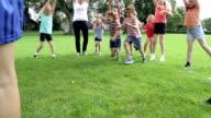 Children Running Under a Parachute