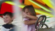 MS PAN Children (2-5) sitting in amusement park ride / Rutland, Vermont, USA