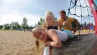 Children spinning on ride at playground