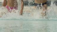 HD SLOW MOTION: Children Splashing In Pool