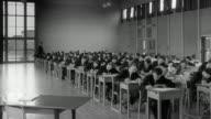 1960 MONTAGE Children taking GCE test in classroom / United Kingdom