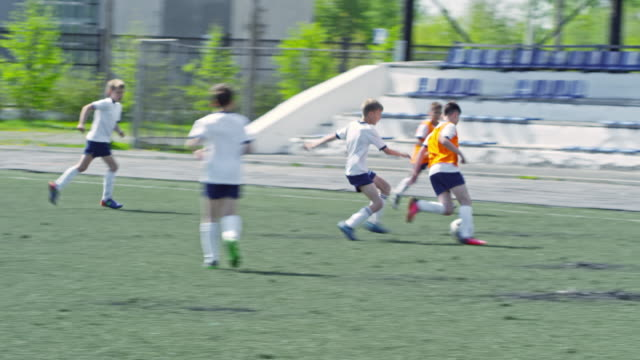 Children teams playing friendly soccer match