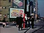 1941 children walking in front of 7up billboard on street corner / Chicago / industrial