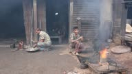 Children working in ship propeller making factory in Dhaka Banhladesh on December 22 2016 In a new report by Overseas Development Institute found...