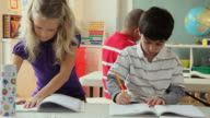 MS Children (6-7) writing in classroom / Jersey City, New Jersey State, USA