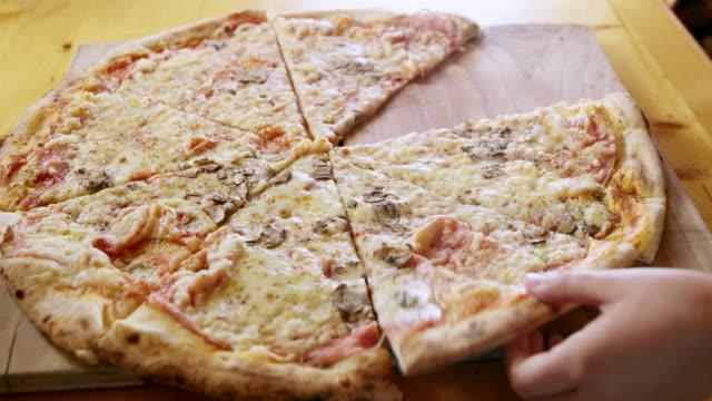 MS Children's hands grabbing pieces of pizza