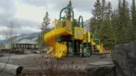 WS PAN Children's playground with mountains in background / Banff, Alberta, Canada