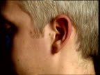 Child's ear aging morphing through time and aging into that of an old man
