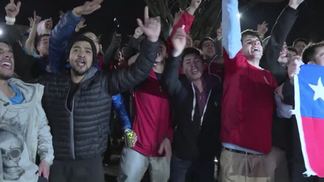 Chile fans sing and dance after the hosts beat Peru 21 to go through to the final of the Copa America