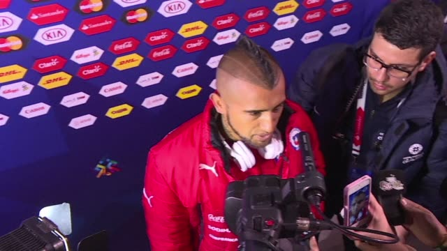 Chilean midfielder Arturo Vidal who opened the victory for Chile against Ecuador at the first game of the Copa America reacts to his team's difficult...