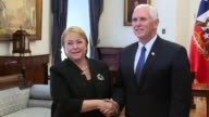 Chile's President Michelle Bachelet greeted US Vice President Mike Pence at the presidential palace Wednesday