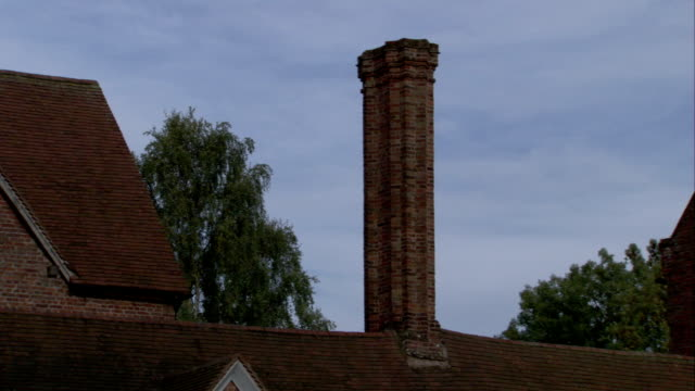 A chimney on top of the King Edward VI Aston School in Birmingham, England. Available in HD.