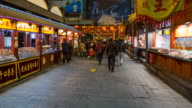 China, Beijing, Food stalls in Wanfujing Dajie Street, Beijing's main shopping street at night - Time lapse