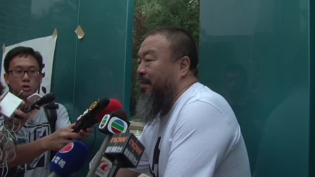 China confirms the release on bail of outspoken artistactivist Ai Weiwei but says he is still under investigation and can't leave Beijing 'without...