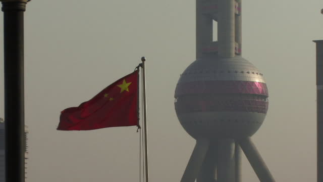 CU, ZO, MS, China, Shanghai, Chinese flag at Oriental Pearl Tower and Pudong district skyline