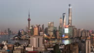 China, Shanghai skyline at dusk, showing Shanghai tower with special light show