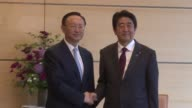 China's State Councillor Yang Jiechi meets with Japan's Prime Minister Shinzo Abe at Abe's official residence in Tokyo