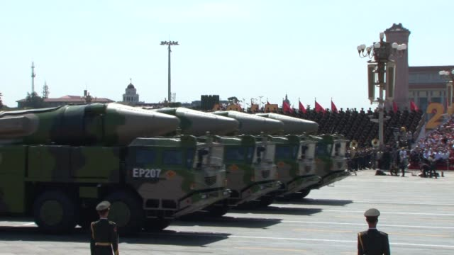 Chinas unveils more than a dozen anti ship ballistic missiles capable of travelling at 10 times the speed of sound at a massive military parade in...