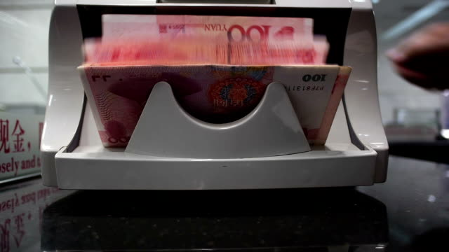Chinese 100RMB banknotes on a currency counting machine