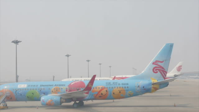 Chinese airline planes lined up in Beijing airport 20 years ago you would meet a lot of foreign tourists at attractions in Beijing now wherever you...