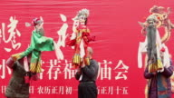 MS PAN Chinese artists performing puppet show at temple fair to celebrate Chinese spring festival AUDIO / xi'an, shaanxi, china