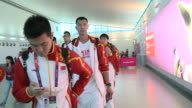 Chinese basketball team walk through Heathrow after arriving for London 2012 Olympics / Group includes Yi Jianlian