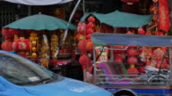 Chinese buntings and traffic on Yaowarat Road, Chinatown, Bangkok, Thailand, Southeast Asia, Asia