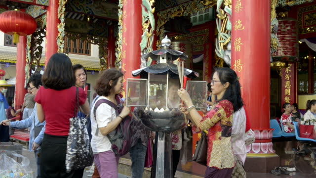 Chinese burn incense to celebrate Chinese New Year in a Chinese temple