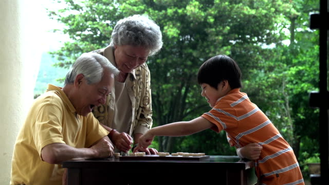 Chinese Chess Grandparents and Grandson