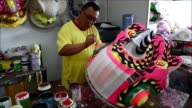 Chinese craftsmen in Malaysia paint heads of traditional lions ahead of the upcoming Lunar New Year celebrations which will begin on January 28 and...