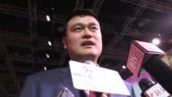 Chinese delegates including basketball star Yao Ming celebrate after having successfully beaten Almaty to win the bid to host the 2022 Winter Olympics