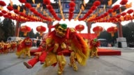Chinese folk artists perform during the opening ceremony of the Spring Festival Temple Fair at the Temple of Earth park on February 9 2013 in Beijing...