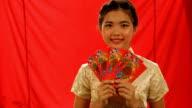 Chinese girls holding red envelopes