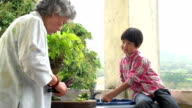 Chinese Grandparents and Grandson Cooking