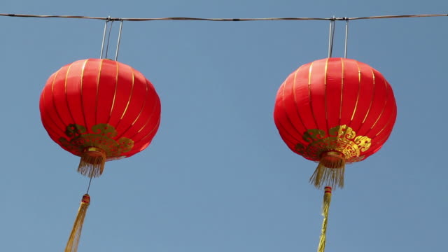 Chinese lantern moving in the wind with blue sky.