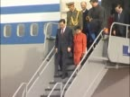 Chinese leader Hu Jintao and his wife walk down aircraft steps at Heathrow to be greeted by Princess Anne and Commander Tim Laurence at the start of...