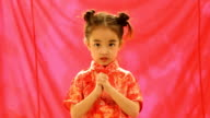 Chinese little girls in wishing gesture