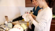 Chinese Mother and Daughter Doing Dishes