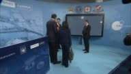 Xi Jinping and David Cameron visit City Football Group Patrick Vieira chatting with Xi Cameron and Al Mubarak / Xi and Cameron chatting to Brian...