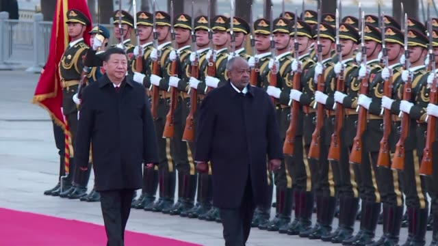 Chinese President Xi Jinping greets his Djibouti counterpart in Beijing shortly after the PLA opened its first military base in the East African...