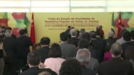 Chinese President Xi Jinping is on a state visit to Brasilia where he signed commercial agreements with Brazilian President Dilma Rousseff