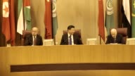 Chinese President Xi Jinping Prime Minister of Egypt Sherif Ismail and SecretaryGeneral of the Arab League Nabil Elaraby gesture at the Arab League...